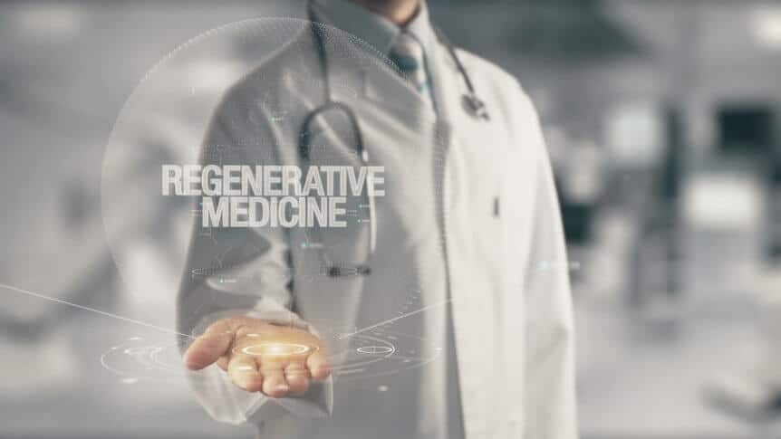 Doctor In White Coat Holding Out Hand To Explain Regenerative Medicine