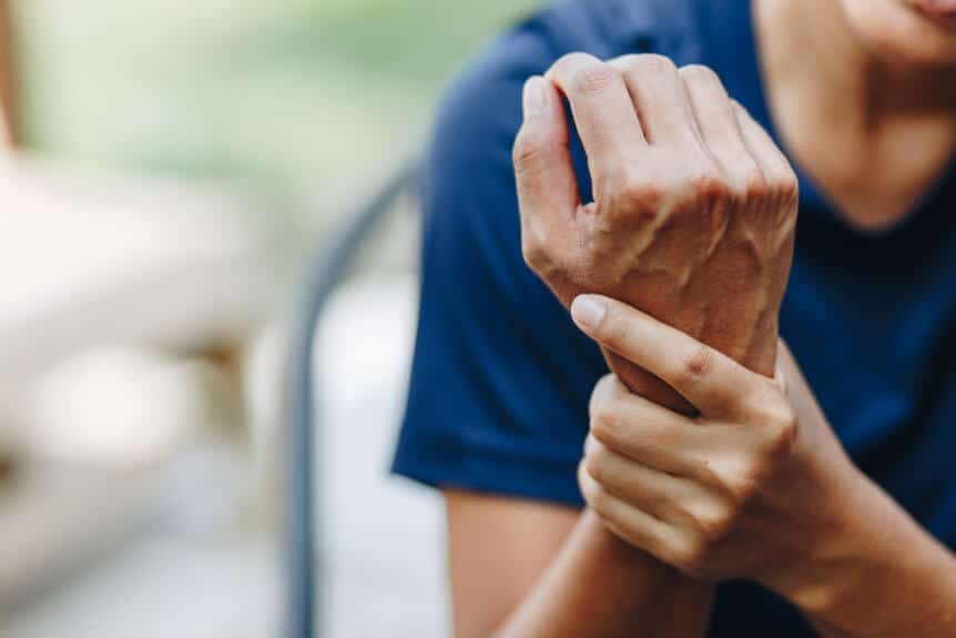 Young Woman With Joint Pain In The Wrist