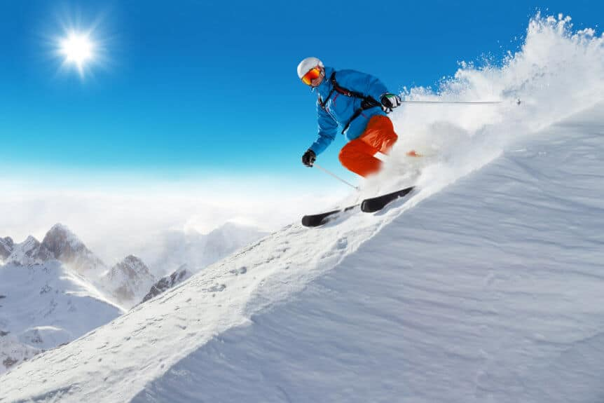 Man Skiing Down Slopes Learning How To Prevent Ski Injuries